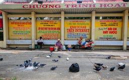 People sell foods on street in Saigon, Vietnam Stock Photo