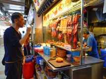 People sell foods on street in Singapore Stock Image