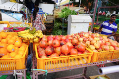 People sell fruits at street market in Little India, Singapore Stock Image