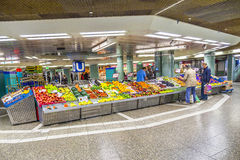 People sell fruits at the train station Hauptwache in Frankfurt. FRANKFURT, GERMANY - MAY 16, 2104: people buy fruits at the train station Hauptwache in Royalty Free Stock Photo