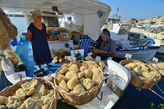 People sell natural sponge in Chania, Crete Royalty Free Stock Photos