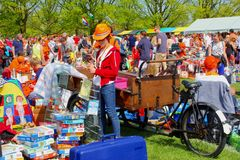 People sell second hand stuff at the flea market on Koningsdag, Netherlands Royalty Free Stock Photography
