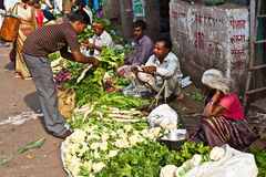 People sell vegetables at Chawri Bazar in Delhi, India Stock Photo