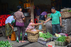 People sell vegetables at the local market in Bali, Indonesia Stock Photos