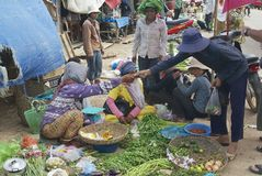 People sell vegetables at the local market in Siem Reap, Cambodia. Royalty Free Stock Photography
