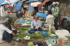 People sell vegetables at the local market in Siem Reap, Cambodia. Royalty Free Stock Images