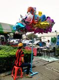 People selling balloons. In the general market in bangkok,thailand Royalty Free Stock Image