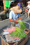 People selling and buying food in a traditional fruit and vegetable market of Taiwan Stock Images