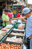 People selling and buying food in a traditional fruit and vegetable market of Taiwan Royalty Free Stock Images