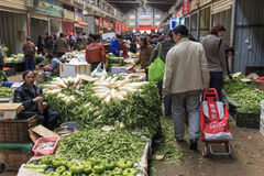People selling and buying in a traditional market in the center of Kunming Royalty Free Stock Images