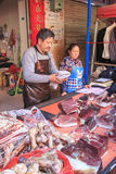 People selling and buying in a traditional market in the center of Kunming Stock Image