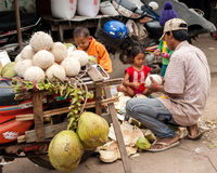 People selling coconuts at marketplace. Cambodia Royalty Free Stock Photo