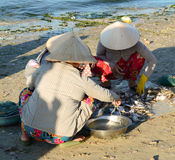 People selling fishes at the market in Phan Thiet, Vietnam Stock Image
