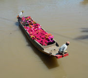People selling flowers on boat Stock Photo