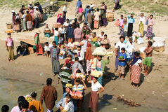 People selling food on the Ayeyarwady river bank Royalty Free Stock Image
