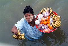 People selling food on the Ayeyarwady river bank Royalty Free Stock Images