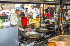 People selling food at traditional market, thailandia Stock Photo