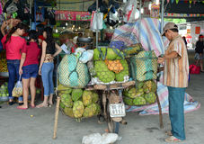 People selling fresh fruits at the local market in Vietnam Royalty Free Stock Photo