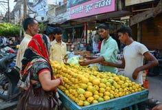 People selling fruits on street in Varanasi, India Stock Photo