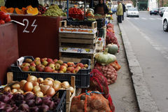 People selling fruits and vegetables Royalty Free Stock Images