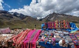People selling rugs at La Raya market, Cusco, Peru royalty free stock images