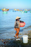 People selling seafoods on the beach in Phan Ri, Vietnam.  Stock Image