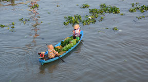 People selling vegetables on the boat in Ben Tre, southern Vietnam.  Royalty Free Stock Photos