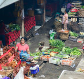 People selling vegetables at market in Bali, Indonesia Royalty Free Stock Photos