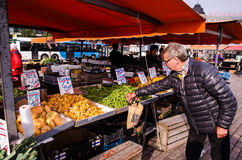 People are selling vegetables in the open market at  Hakaniemen tori Royalty Free Stock Photography