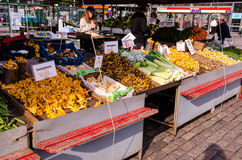 People are selling vegetables in the open market at  Hakaniemen tori Royalty Free Stock Images