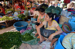 People sells food. LUANG PRABANG LAOS APRIL 03: People sells food on 04 03 2013 in Luang Prabang Laos.The markets are filled with local vegetables and spices Royalty Free Stock Photography