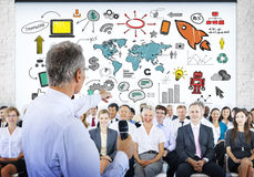 People in Seminar with Global Business Concepts Stock Photo