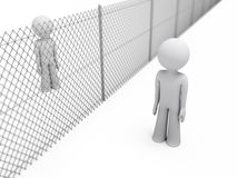 People separated by a fence Royalty Free Stock Photo