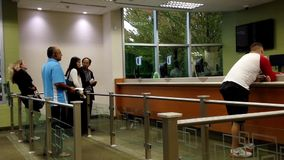 People at a service counter talking to the teller Royalty Free Stock Photo