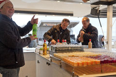People serving drinks, Belgium Royalty Free Stock Photo