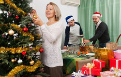 People serving  festive table Royalty Free Stock Images