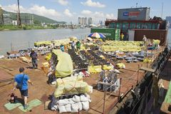 People set the pyrotechnic equipment for the fireworks contest in Macau, China. Stock Photo