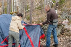 People set up a tent Royalty Free Stock Photo