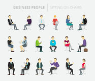People set work sitting on chairs Stock Photo