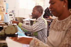 People sewing at a community project workshop, South Africa royalty free stock photo