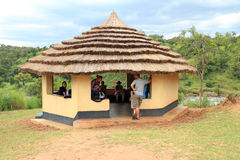 People in a Shaded Safari Shelter Stock Photo