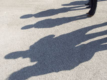 People shadows on the concrete. Shadows of people on a concrete pavement Stock Image