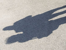 People shadows on the concrete. Shadows of people on a concrete pavement Royalty Free Stock Image