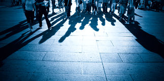 People shadows on a ground. Blue tint Royalty Free Stock Photo
