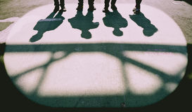 4 People Shadows On The Ground Royalty Free Stock Photo
