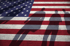 People shadows on painted usa flag floor. Shadows of group of people walking through the city streets with painted Usa flag on the floor. Concept political Royalty Free Stock Image