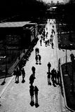 People shadows. People walk in Alexanders Garden in Moscow, Russia. Date: 17.03.2015. Black and white photo Stock Images
