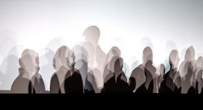 People shadows on white wall. Lot of people shadows on white wall Stock Photo
