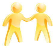 People shaking hands concept. Two gold people human figures shaking hands concept Stock Photo