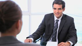 People shaking hands after negotiation. In a bright office stock footage